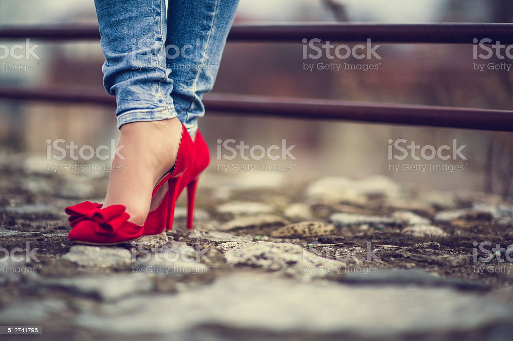 Woman in red shoes stock photo