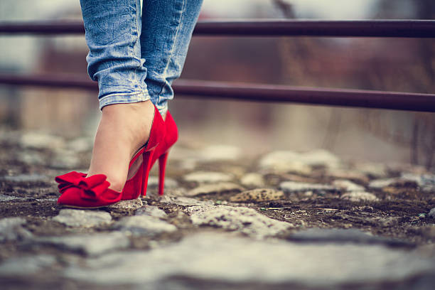woman in red shoes - human foot stock photos and pictures