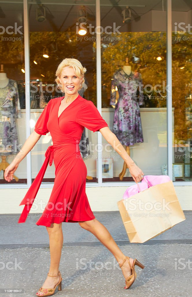 Woman in red shopping royalty-free stock photo