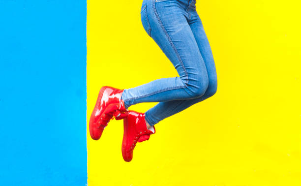 woman in red sneakers - saturated color stock pictures, royalty-free photos & images