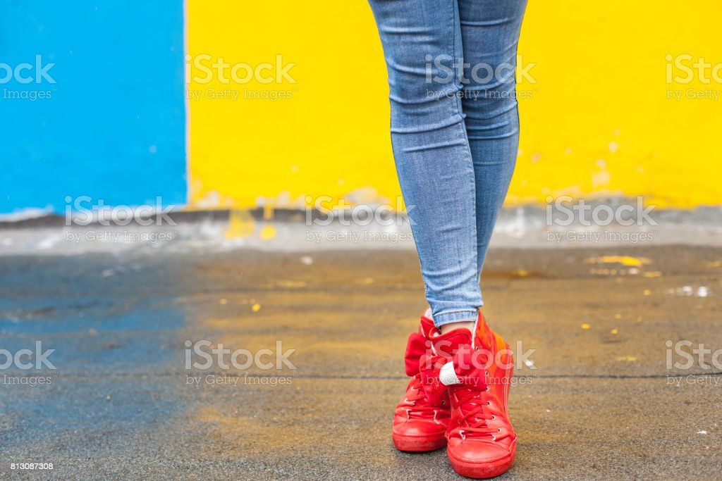 Woman in red sneakers stock photo