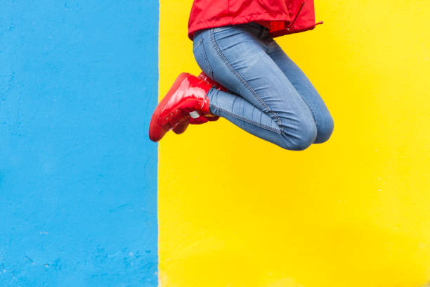 woman in red sneakers - vibrant color stock pictures, royalty-free photos & images