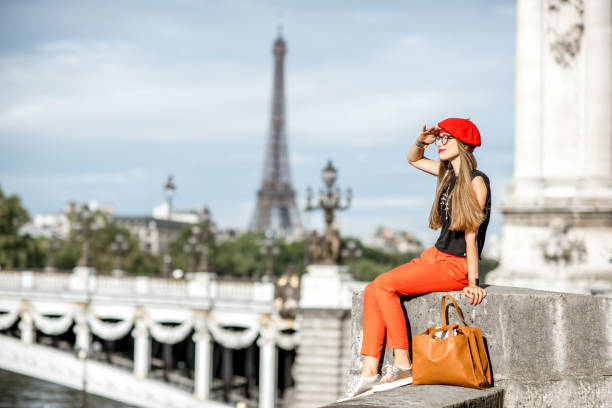 woman in red traveling paris - paris fashion stock photos and pictures