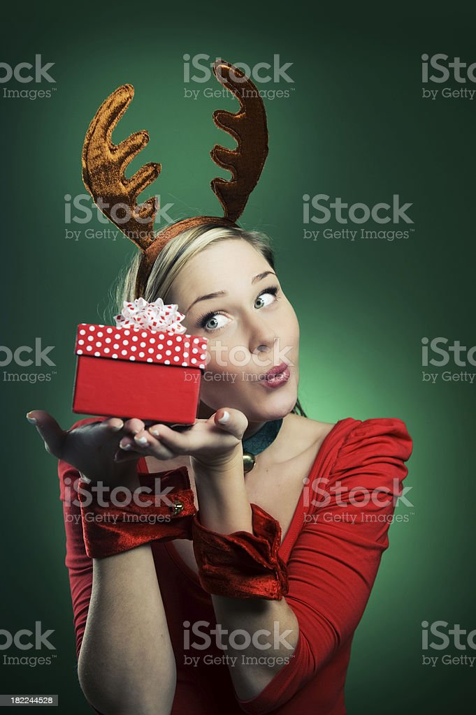 Woman in reindeer costume christmas time stock photo