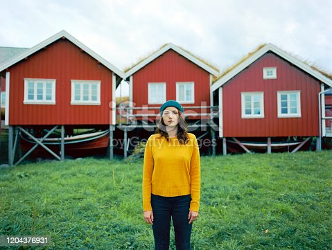 Young Caucasian woman in Reine village in Lofoten Islands, Norway