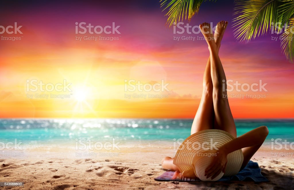 Woman In Relaxation On Tropical Beach At Sunset Girl On Sand In Beach At Sunset With Palm Tree Adult Stock Photo