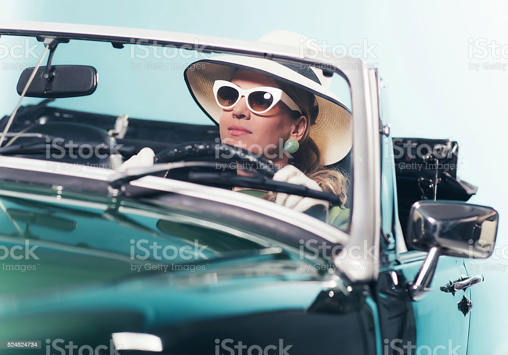 Woman In Retro 1960s Fashion With Hat Driving Convertible Stock Photo Download Image Now Istock