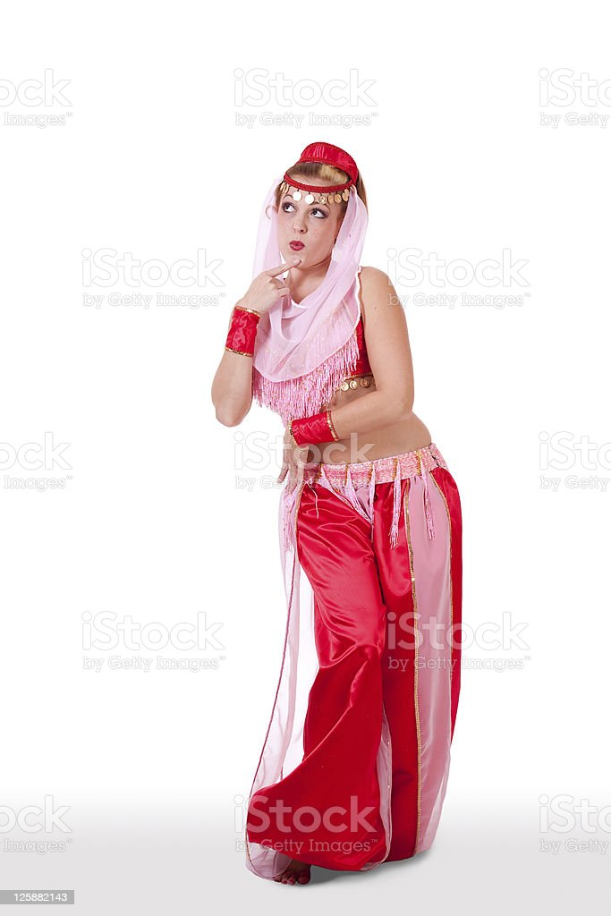 Woman in retro belly dance costume looking innocent stock photo