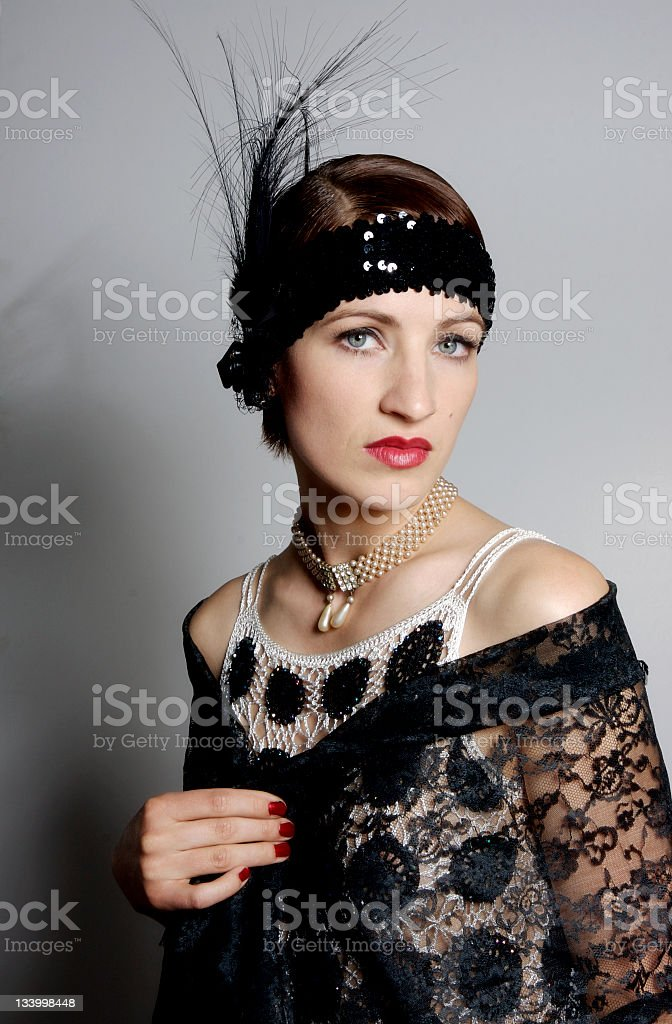 woman in retrow look of 1920s with feather hair band stock photo