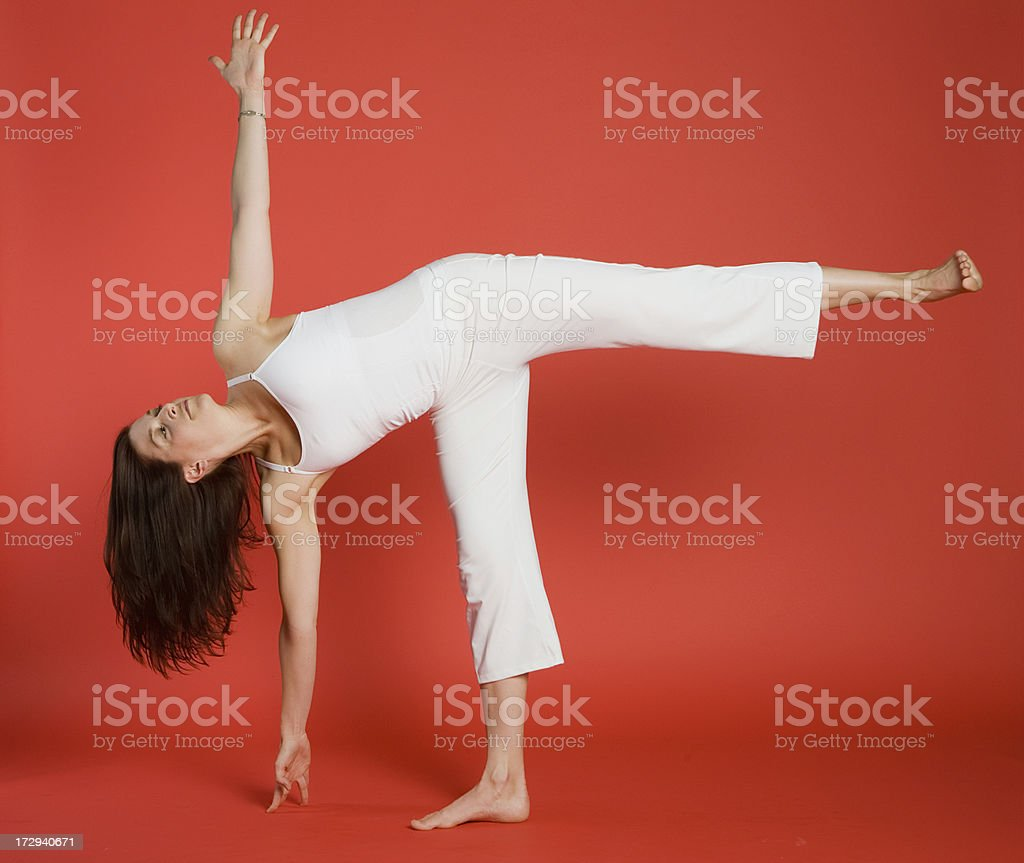 Woman in revolved half moon pose royalty-free stock photo