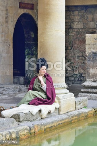 Bath Somerset, United Kingdom - June 30, 2016: Woman in Roman costume recreating scene at the Roman Baths in centre of city