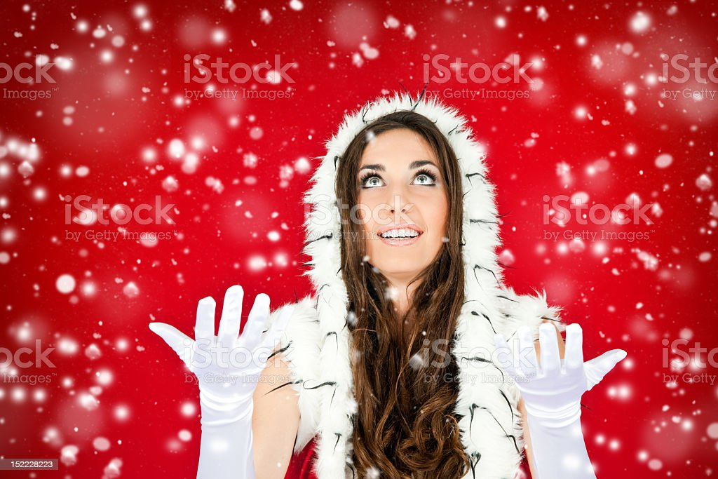 woman in santa clothes standing on the snow royalty-free stock photo
