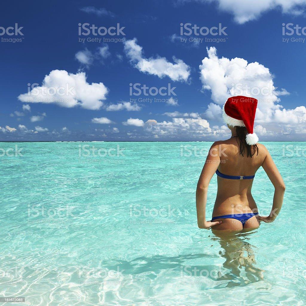 Woman in santa's hat at beach royalty-free stock photo