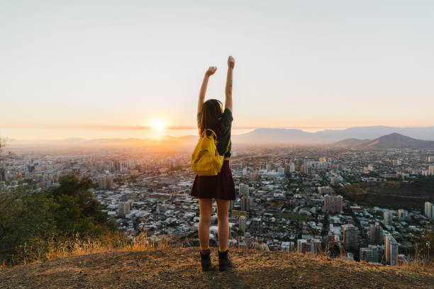 Woman in Santiago at sunset stock photo