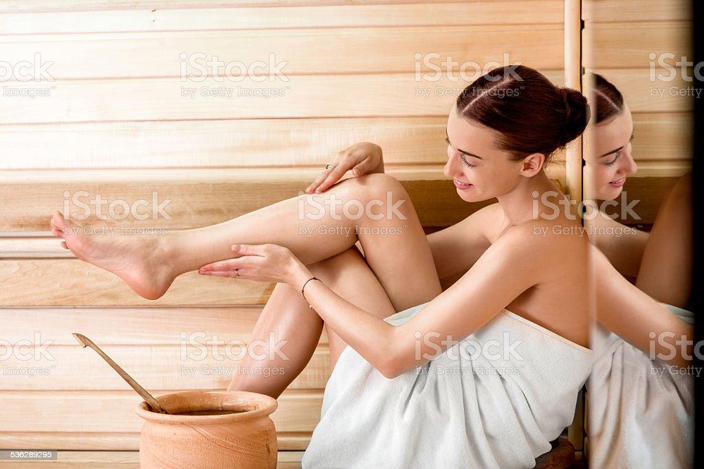 Woman in sauna stock photo