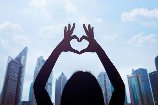 Woman in Shanghai's Pudong District making a heart symbol with her hands stock photo