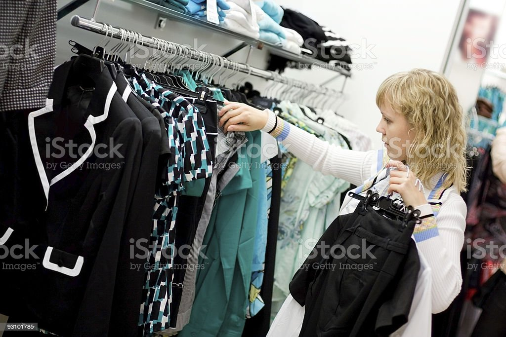 Woman in shop choosing clothes royalty-free stock photo
