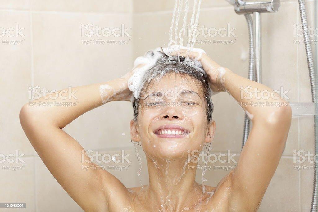 woman in shower washing hair stock photo