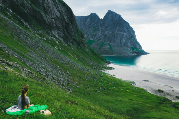 Woman in sleeping bag and dog lying at the mountains and looking at picture id1150972339?b=1&k=6&m=1150972339&s=612x612&w=0&h=bi8o8xq5c87glsdjvns3xzn1tneuxs4qniai00btsis=