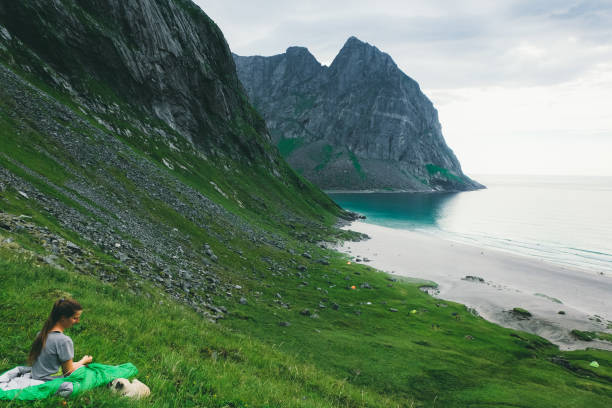 Woman in sleeping bag and dog lying at the mountains and looking at picture id1150972893?b=1&k=6&m=1150972893&s=612x612&w=0&h=62ikh1je9hcezay q49bzwizsasepd9w4m0rvk70i94=