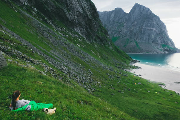 Woman in sleeping bag and dog lying at the mountains and looking at picture id1150972911?b=1&k=6&m=1150972911&s=612x612&w=0&h=hbnscc4wef1brlrzpevqxdttfq1e6bon dln1mw0cls=