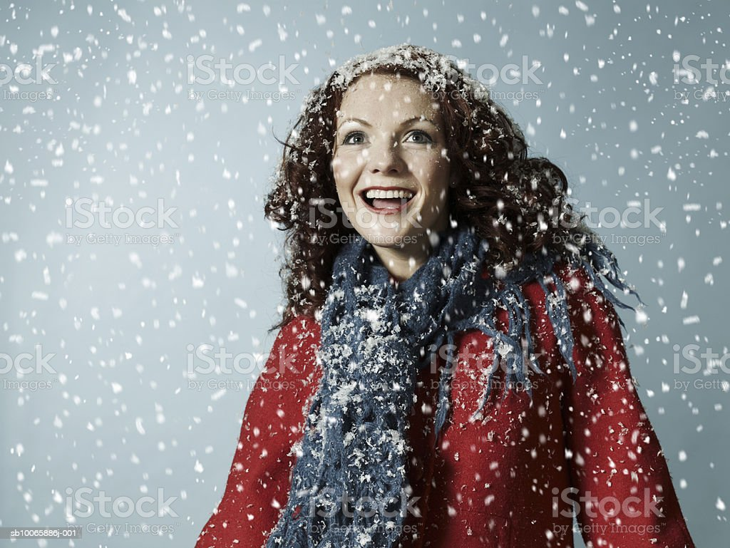 Woman in snow, smiling foto royalty-free