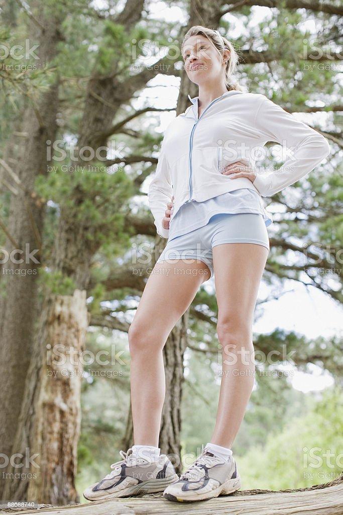 Woman in sportswear in forest royalty-free stock photo