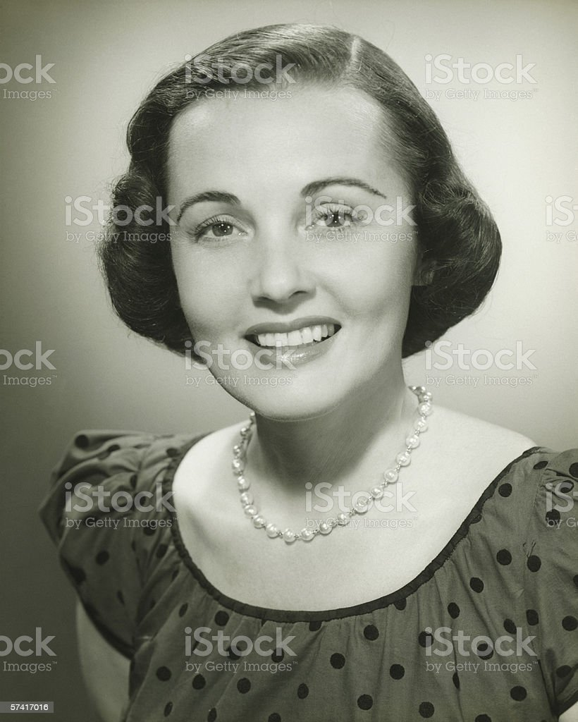Woman in spotted dress posing in studio, (B&W), (Close-up), (Portrait) stock photo