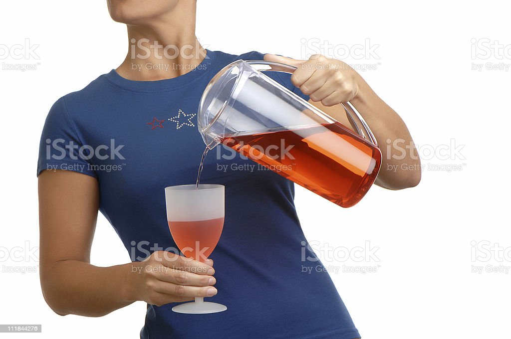 Woman in Star Spangled Top Pouring Punch on White royalty-free stock photo