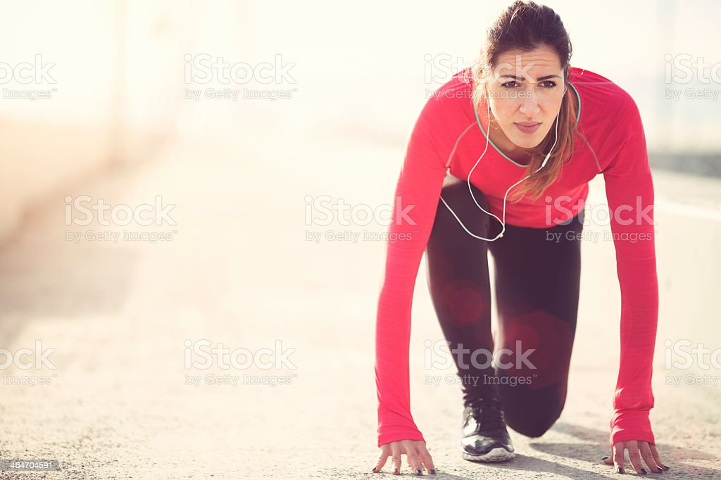 Woman in start position for running. stock photo