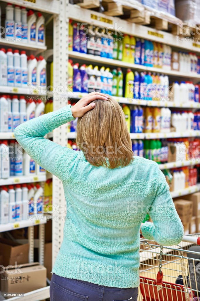 Woman in store with shopping cart stock photo