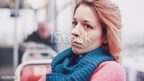 istock Woman in streetcar alone and depressed 512352264