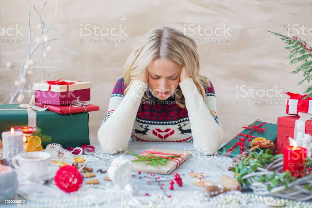 Woman in stress about Christmas holidays Exhausted and overwhelmed woman packing Christmas gifts Adult Stock Photo