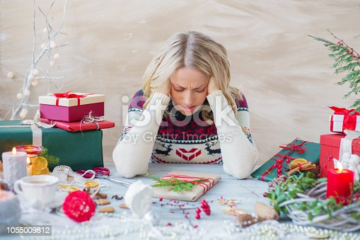 istock Woman in stress about Christmas holidays 1055009812