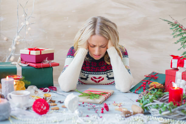 Woman in stress about Christmas holidays Exhausted and overwhelmed woman packing Christmas gifts holidays stock pictures, royalty-free photos & images