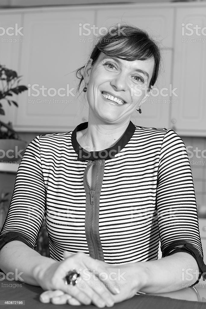 Woman in Striped Pattern Shirt Smiling, B&W royalty-free stock photo