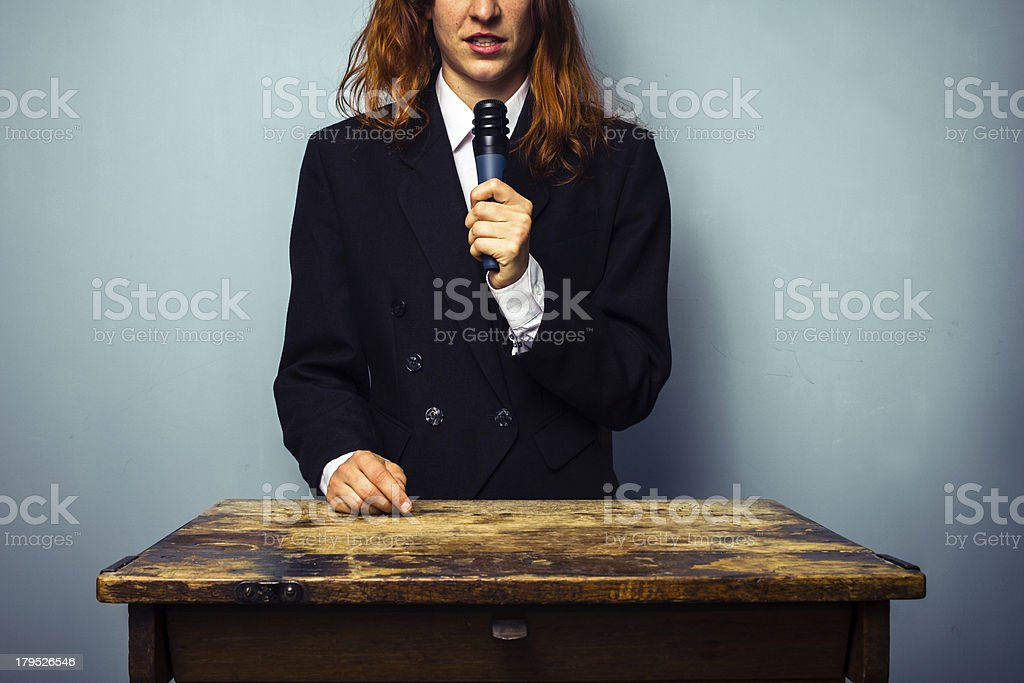 Woman in suit giving lecture royalty-free stock photo