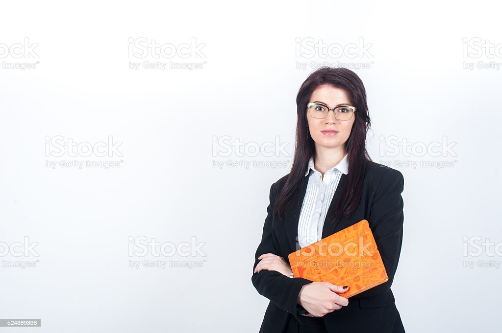 Woman in suit holding tablet  bright orange cover stock photo