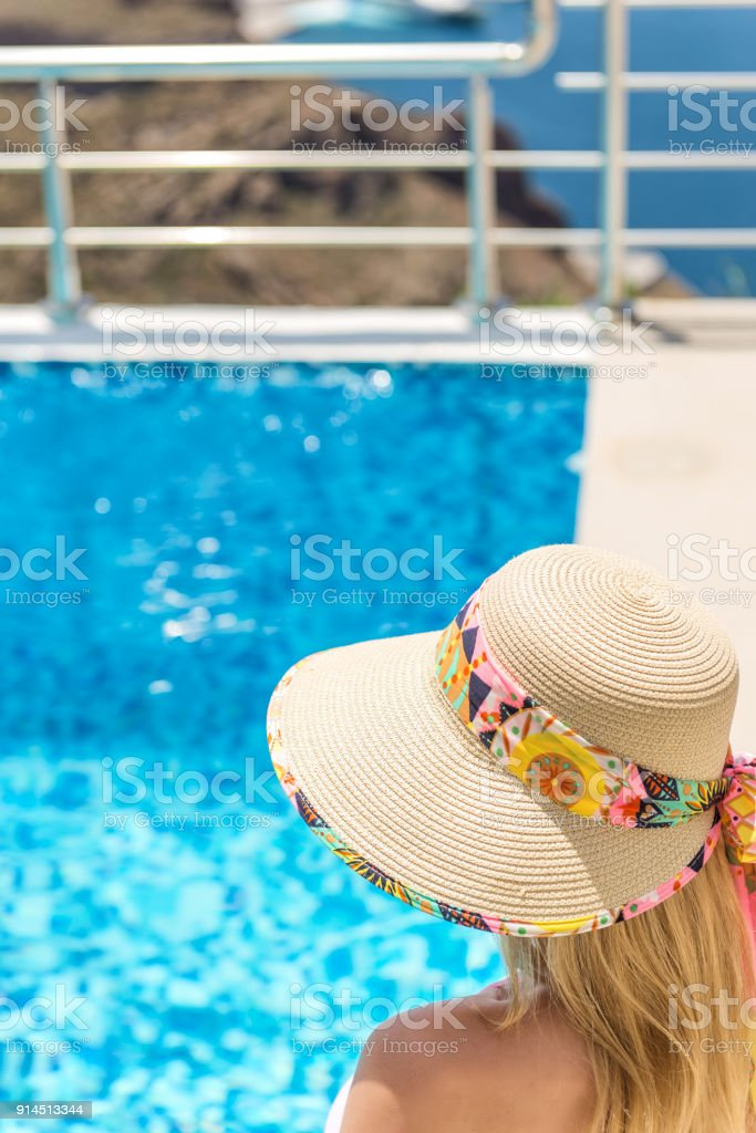 81a2fd7ce Woman In Sun Hat Swimming Pool Stock Photo - Download Image Now