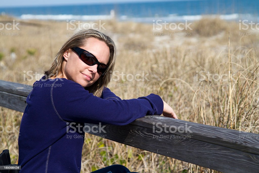 Woman in Sunglasses at Beach stock photo