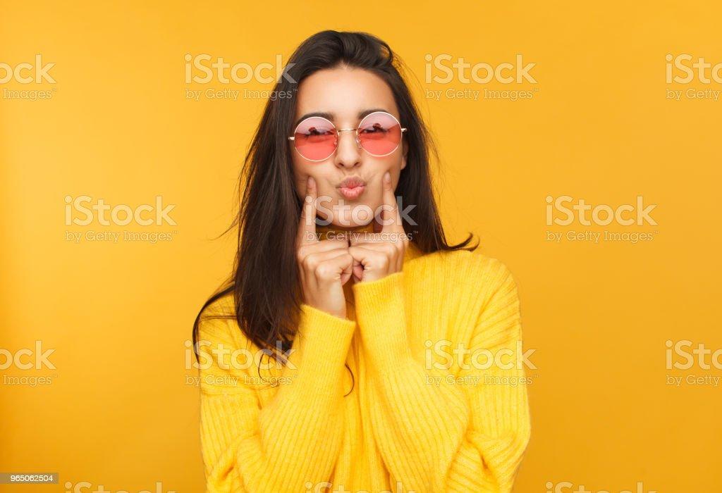 Woman in sunglasses touching cheeks zbiór zdjęć royalty-free