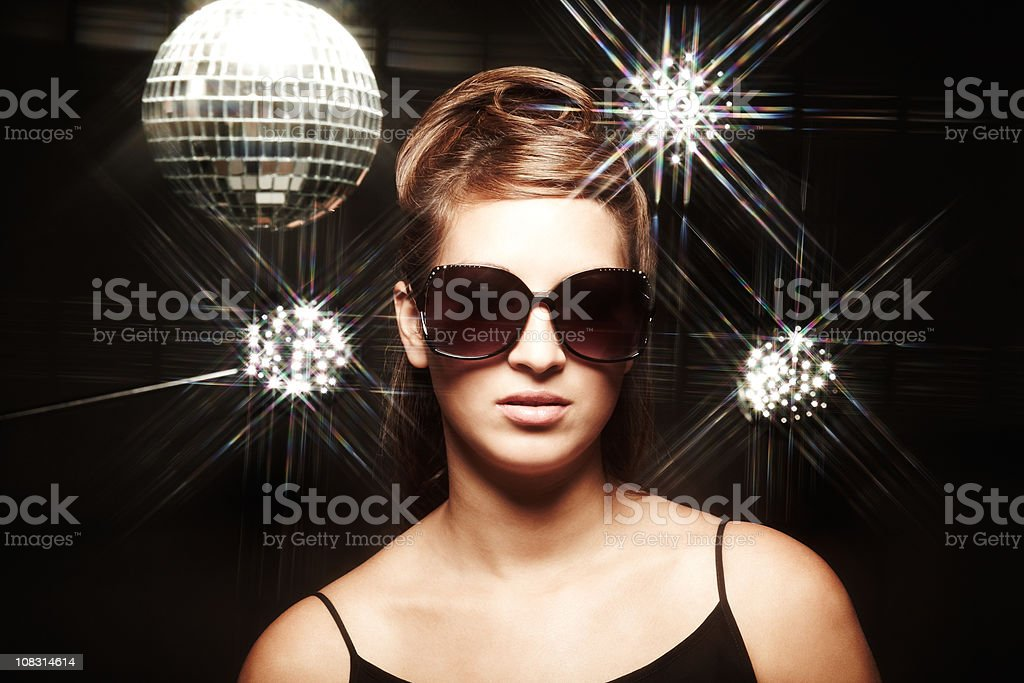 Woman in Sunglasses With Disco Ball & Lights royalty-free stock photo
