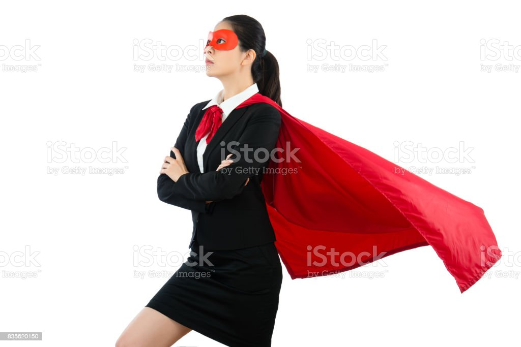 woman in superhero clothing goggles and cloak stock photo