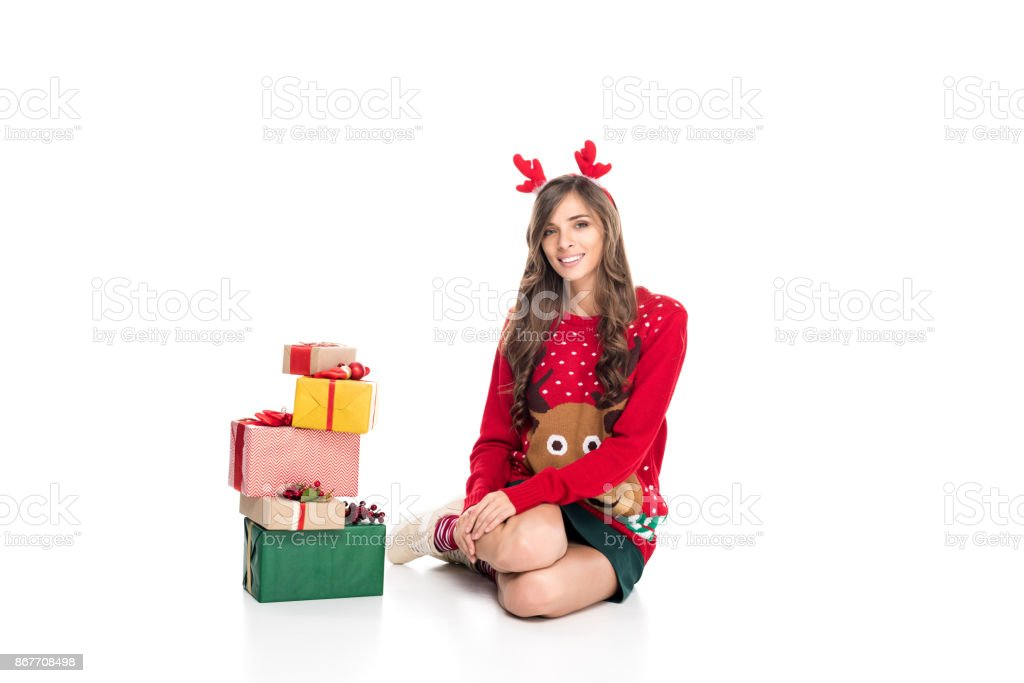 woman in sweater and christmas presents stock photo