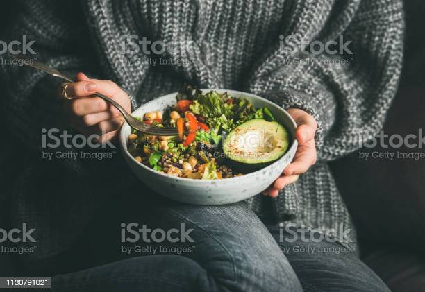 Woman in sweater eating fresh salad avocado beans and vegetables picture id1130791021?b=1&k=6&m=1130791021&s=612x612&h=bhrj7szobrp7bgonqhpscmpihaiadkpf45s jyljwai=