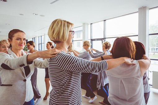 Woman In Team Building Workshop Stock Photo - Download Image Now