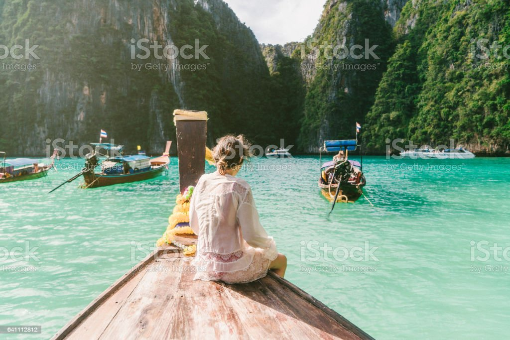 Woman in Thai Taxi Boat stock photo