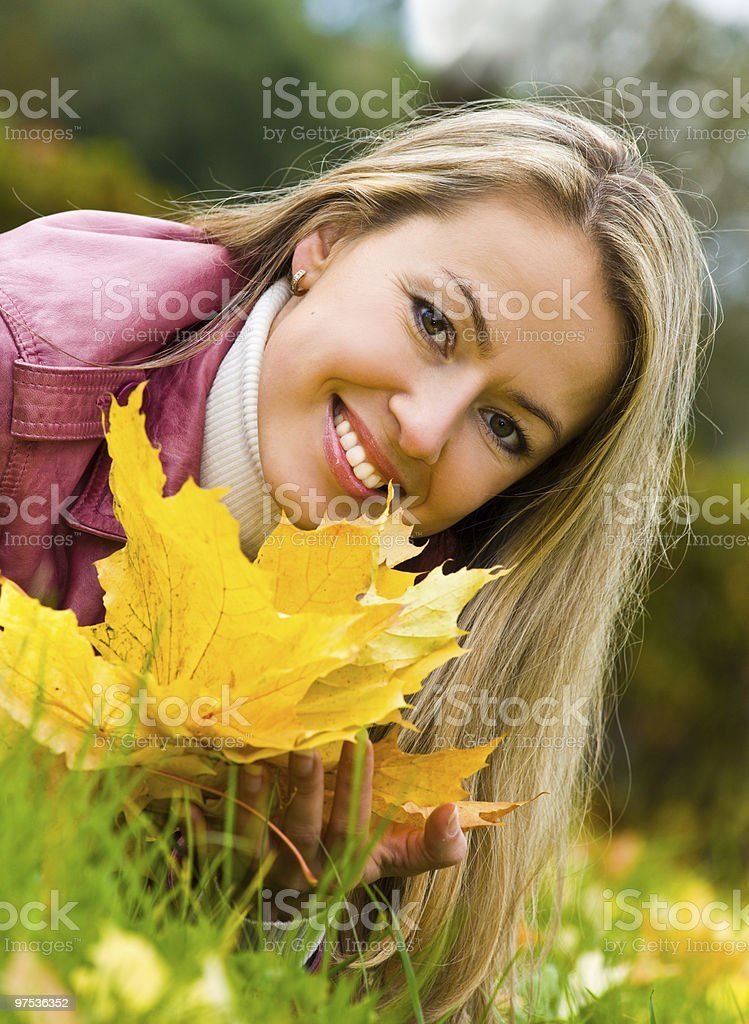Woman in the autumn park royalty-free stock photo