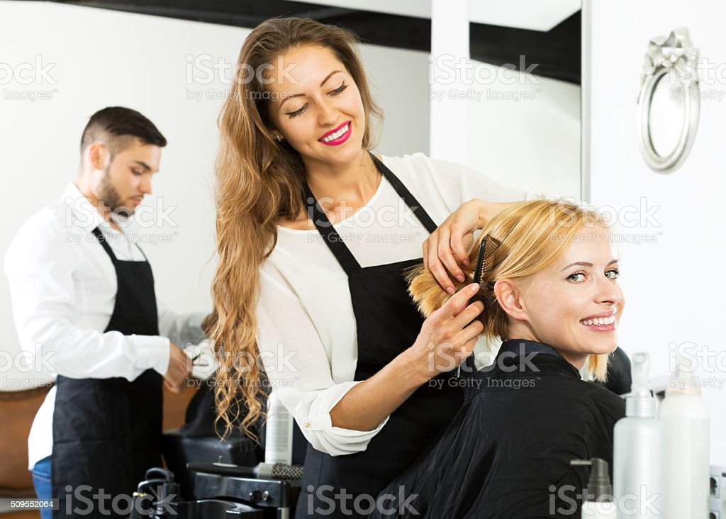 woman in the barbershop stock photo