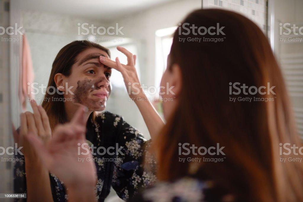 Woman in the bathroom stock photo